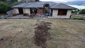 Rock through house in Rapaki