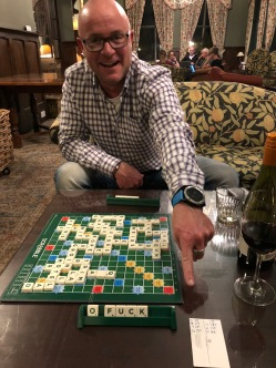 Andrew Herriott playing scrabble in Scotland
