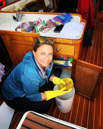woman wearing rubber gloves mopping bilges